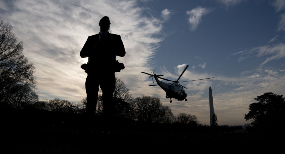 A Secret Service agent stands guard as Marine One with President Donald Trump aboard departs the White House in Washington, Saturday, Dec. 2, 2017, for a short trip to Andrews Air Force Base, Md. where Trump will travel to New York for a fundraising event