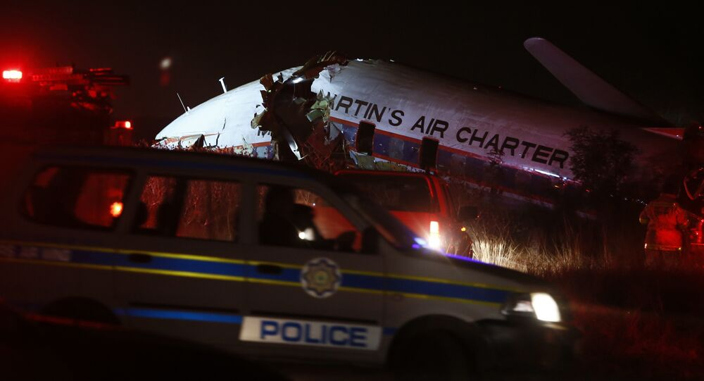 A charter plane lays in a field in Pretoria, South Africa, Tuesday July 10, 2018