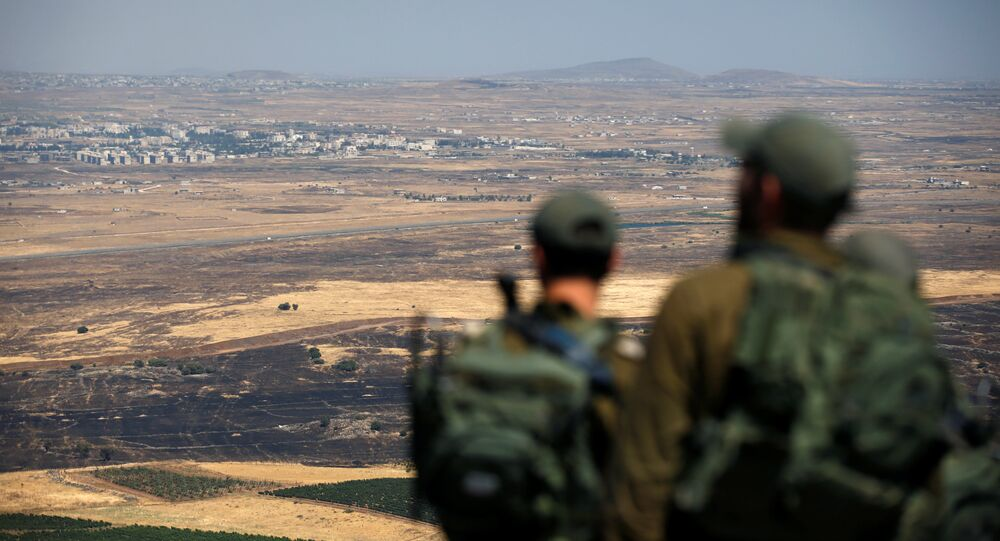 Israeli soldiers look at the Syrian side of the Israel-Syria border on the Israeli-occupied Golan Heights, Israel July 7, 2018