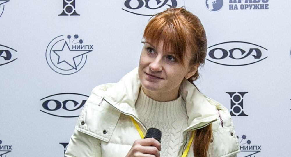Mariia Butina, leader of a pro-gun organization, speaks on October 8, 2013 during a press conference in Moscow