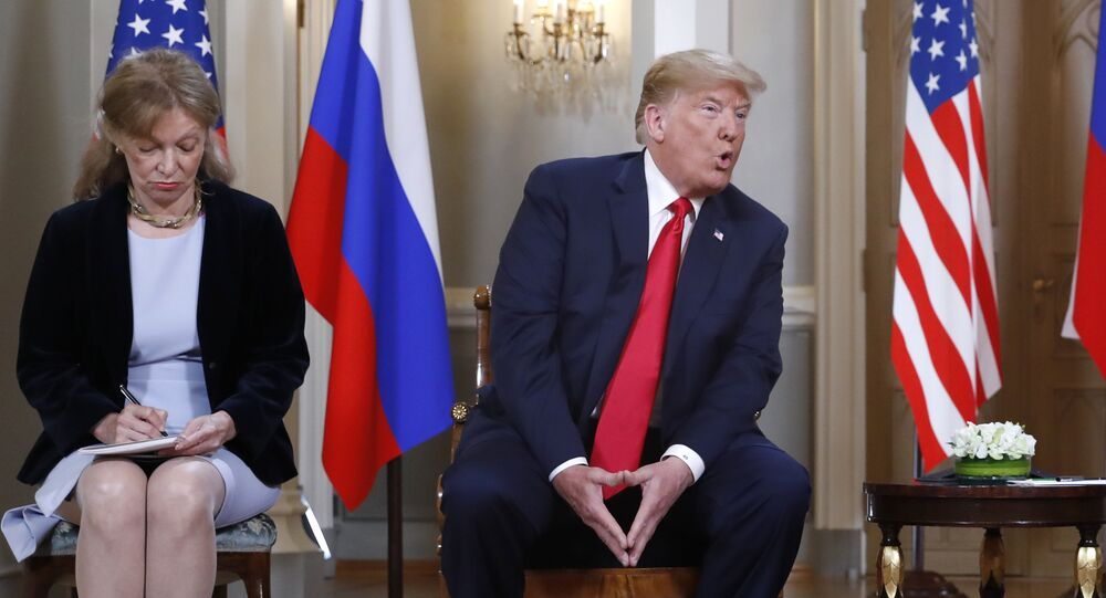 Interpreter interpreter Marina Gross, left, takes notes when U.S. President Donald Trump talks to Russian President Vladimir Putin at the beginning of their one-on-one-meeting at the Presidential Palace in Helsinki, Finland, Monday, July 16, 2018.