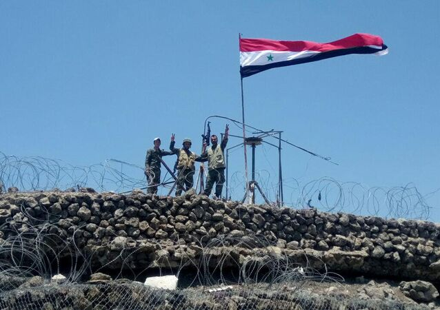 Syrian forces of President Bashar al Assad are seen celebrating on al-Haara hill in Quneitra area, Syria July 17, 2018