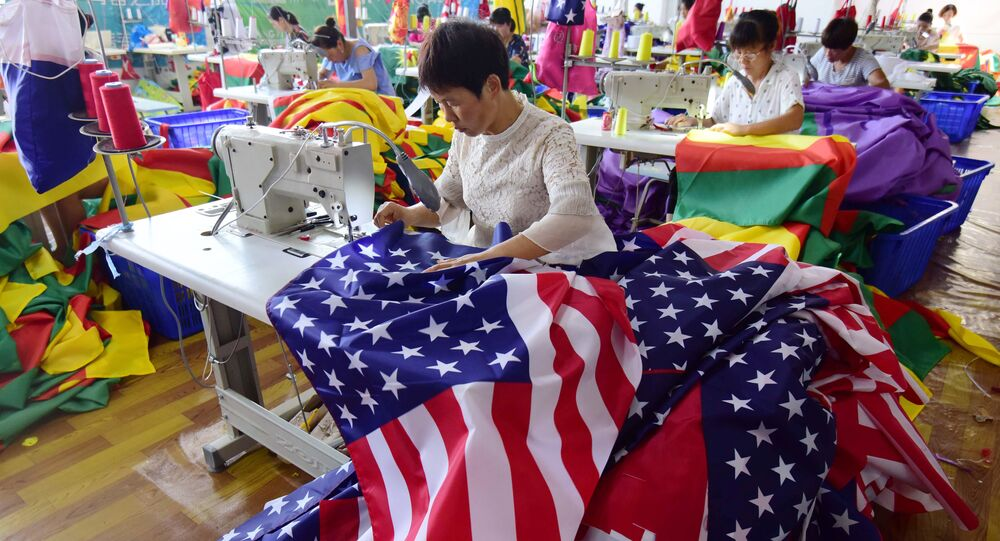 This photo taken on July 13, 2018 shows Chinese employees sewing US flags at a factory in Fuyang in China's eastern Anhui province. As the Sino-US trade war rages, a factory set amid corn and mulberry fields in central China stitches together US and Trump 2020 flags -- and business is good