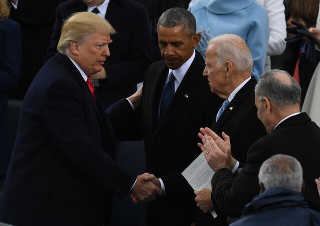 US President Donald Trump (L) shakes hands with former US President Barack Obama (C) and former vice-President Joe Biden after being sworn in as President on January 20, 2017 at the US Capitol in Washington, DC.