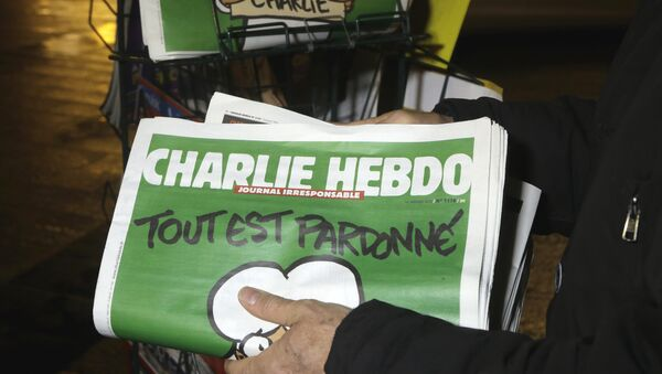 In this Wednesday, Jan. 14, 2015, file photo, a seller of newspapers stocks several Charlie Hebdo newspapers at a newsstand in Nice, France. The French satirical newspaper Charlie Hebdo will publish a German version in the country that has given the best reception to the weekly paper outside France since the attacks that wiped out the Paris editorial staff in January 2015 - Sputnik International