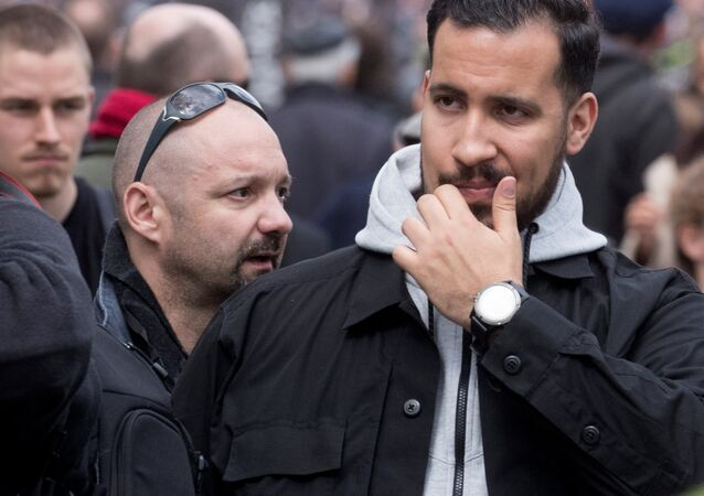 Alexandre Benalla, French presidential aide, is seen during the May Day labour union rally in Paris, France May 1, 2018. At L, Vincent Crase, employee of LREM