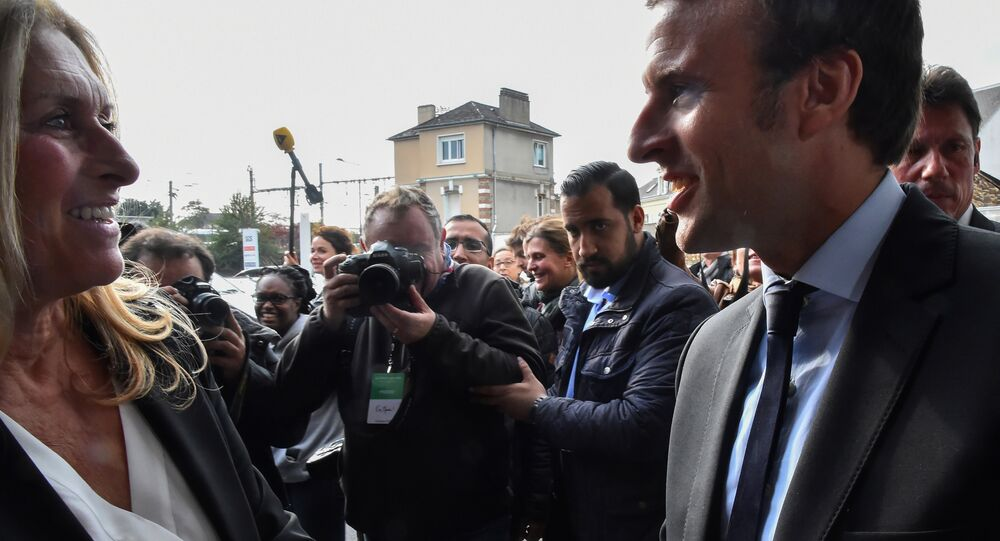 A picture taken on October 11, 2016 shows then French presidential election candidate for the En Marche! movement Emmanuel Macron (R) and Head of Security Alexandre Benalla (2ndR) arriving for a campaign meeting in Le Mans, western France