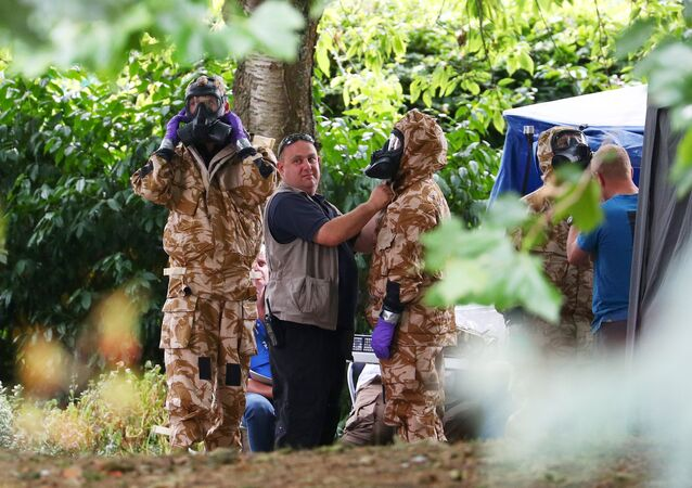 People don military hazardous material protective suits during a police search of Queen Elizabeth Gardens in Salisbury, Britain, July 19, 2018