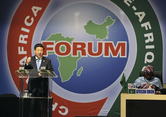 Dec. 4, 2015 file photo, Chinese President Xi Jinping, left, delivers his speech during the opening ceremony of the Johannesburg Summit for the Forum on China-Africa Cooperation at the Sandton Convention Centre in Johannesburg