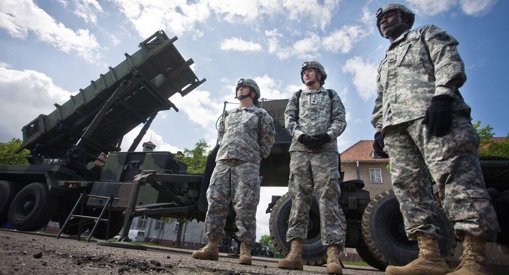 US soldiers stand on May 26, 2010 in front of a Patriot missile battery at an army base in the northern Polish town of Morag