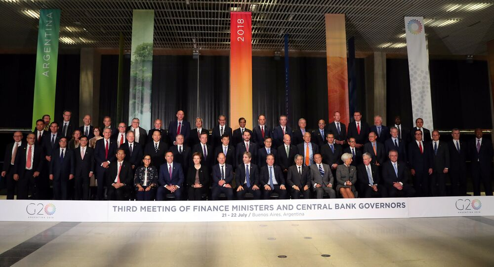 Finance ministers and Central Bank presidents pose for the official photo at the G20 Meeting of Finance Ministers in Buenos Aires, Argentina, July 21, 2018