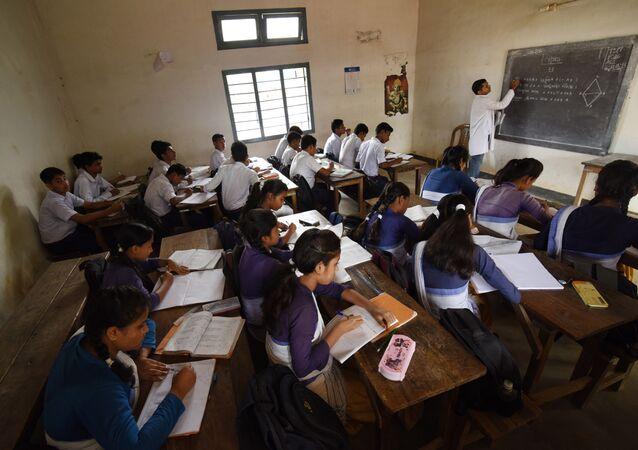 In this photograph taken on June 1, 2016, Indian schoolchildren and teachers take part in lessons in classrooms at Rashtriya Swayamsevak Sangh(RSS)run Sankardev Sishu Nikatan School in the Betkuchi area of Guwahati