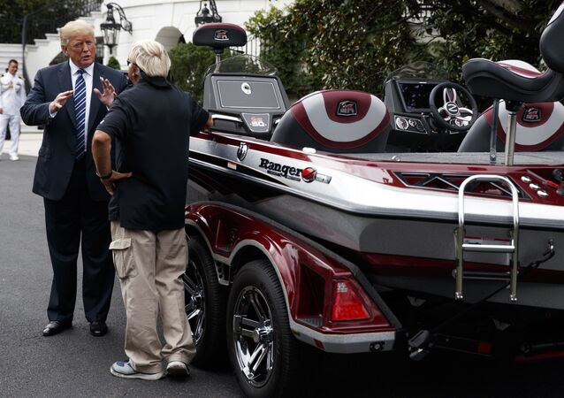 President Donald Trump talks with Jimmy Houston of Ranger Boats as he participates in a tour during a Made in America Product Showcase at the White House, Monday, July 23, 2018, in Washington