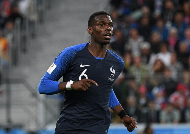 France's Paul Pogba runs during the World Cup semifinal soccer match between France and Belgium at the Saint Petersburg Stadium, in St. Petersburg, Russia, 10 July 2018