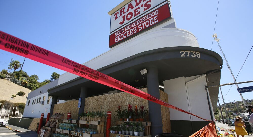 Red tape blocks access to a Trader Joe's grocery store in the Los Feliz neighborhood of Los Angeles, Sunday, July 22, 2018.