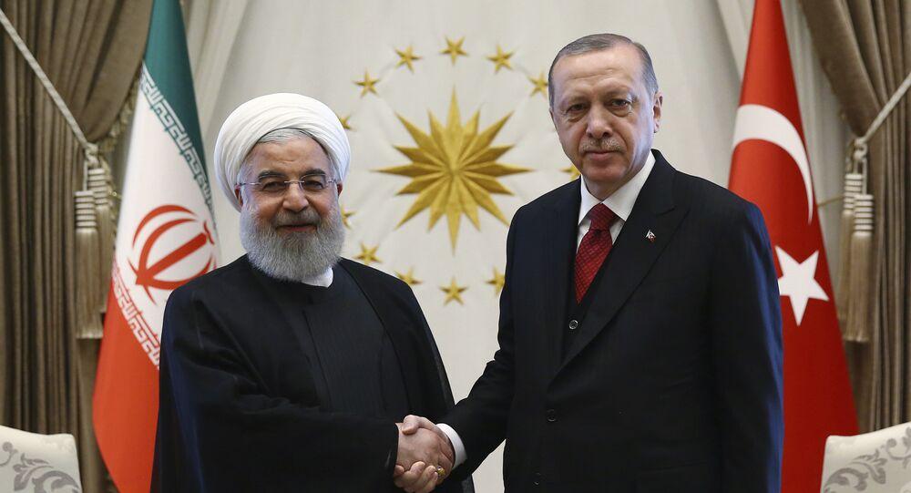 Turkey's President Recep Tayyip Erdogan, right, and Iran's President Hassan Rouhani shake hands before a meeting in Ankara, Turkey, April 4, 2018
