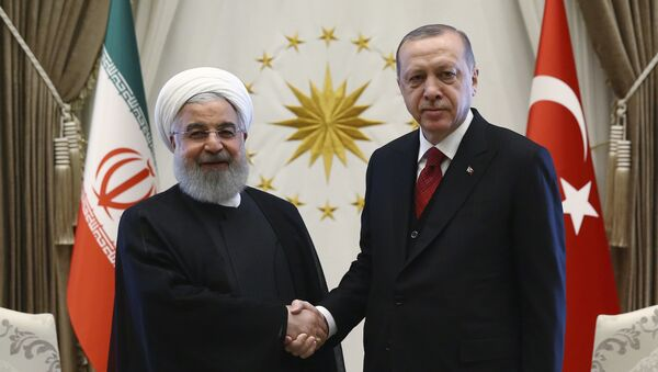 Turkey's President Recep Tayyip Erdogan, right, and Iran's President Hassan Rouhani shake hands before a meeting in Ankara, Turkey, Wednesday, April 4, 2018 - Sputnik International