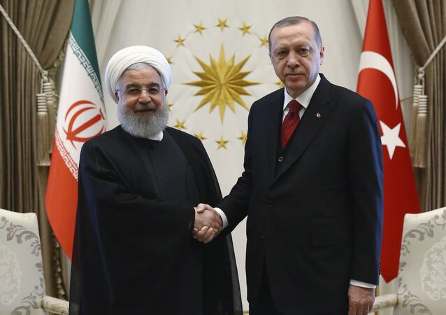 Turkey's President Recep Tayyip Erdogan, right, and Iran's President Hassan Rouhani shake hands before a meeting in Ankara, Turkey, April 4, 2018