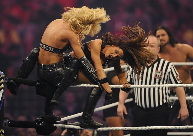(File) WWE Divas LayCool and Trish Stratus during WrestleMania XXVII at the Georgia Dome in Atlanta, Georgia on Sunday, April 3, 2011