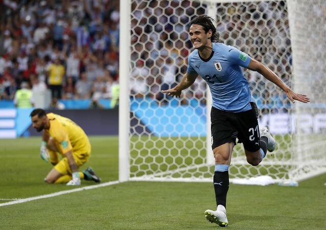 Uruguay's Edinson Cavani celebrates after he scored the opening goal during the round of 16 match between Uruguay and Portugal at the 2018 soccer World Cup at the Fisht Stadium in Sochi, Russia, Saturday, June 30, 2018