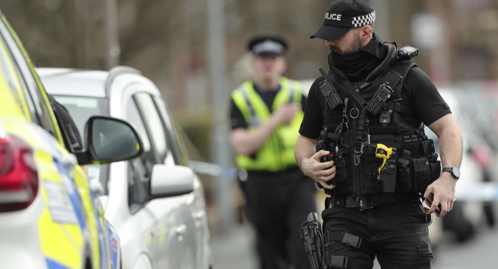 Police activity outside an address raided by officers from Britain's Counter Terrorism police in Dewsbury, England, Tuesday April 3, 2018. Two men are understood to have been arrested on suspicion of planning acts of terror
