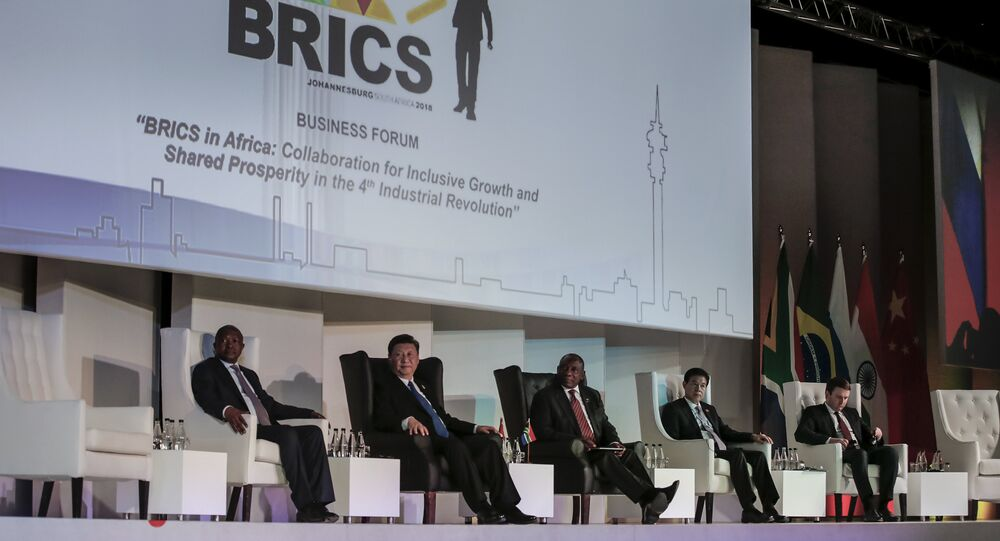 (FromL) Deputy President of South Africa David Mabuza, President of China Xi Jinping, President of the Republic of South Africa Cyril Ramaphosa attend a Business Forum organised during the 10th BRICS (acronym for the grouping of the world's leading emerging economies, namely Brazil, Russia, India, China and South Africa) summit at the Sandton Convention Centre in Johannesburg, South Africa on July 25, 2018