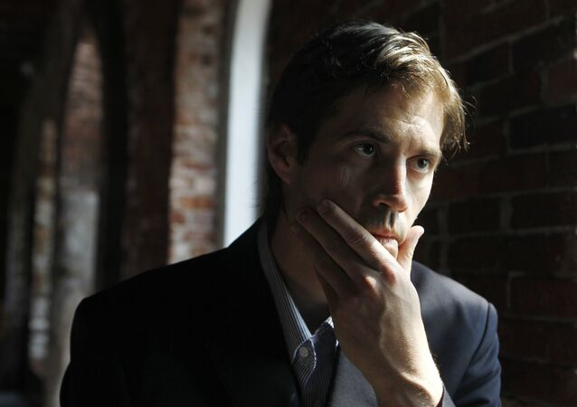 FILE - In this May 2011 file photo, journalist James Foley, of Rochester, N.H., responds to questions during an interview with The Associated Press, in Boston.