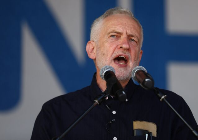 Britain's opposition Labour Party leader, Jeremy Corbyn, addresses demonstrators following a march in support of the National Health Service, in central London, Britain, June 30, 2018