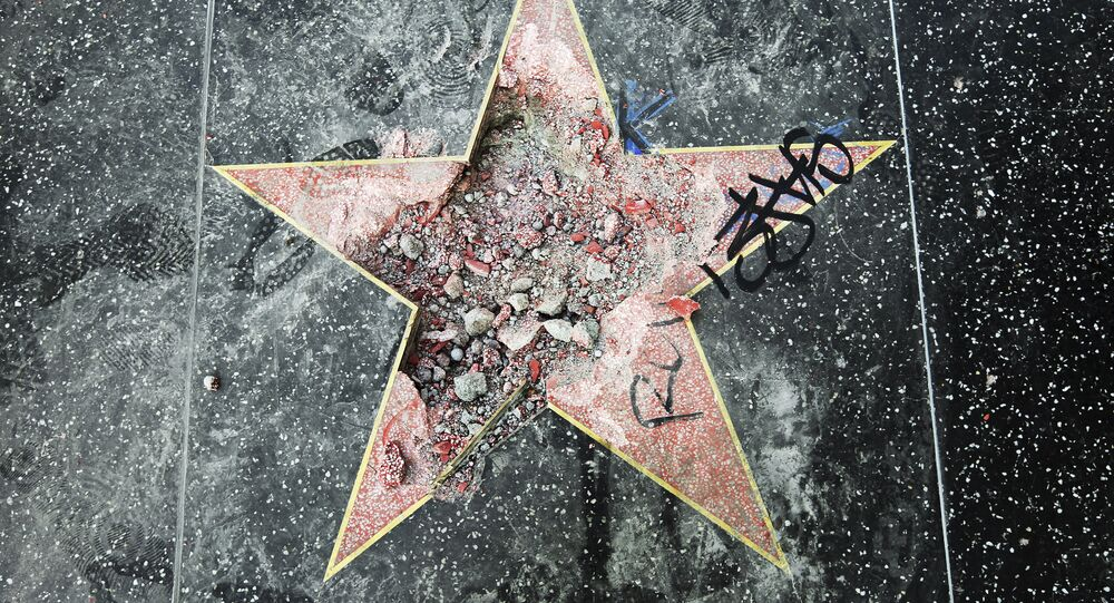 This photo shows Donald Trump's star on the Hollywood Walk of Fame that was vandalized Wednesday, July 25, 2018, in Los Angeles. Los Angeles police Officer Ray Brown said the vandalism was reported early Wednesday and someone was subsequently taken into custody. Authorities said a pickax was used in the vandalism