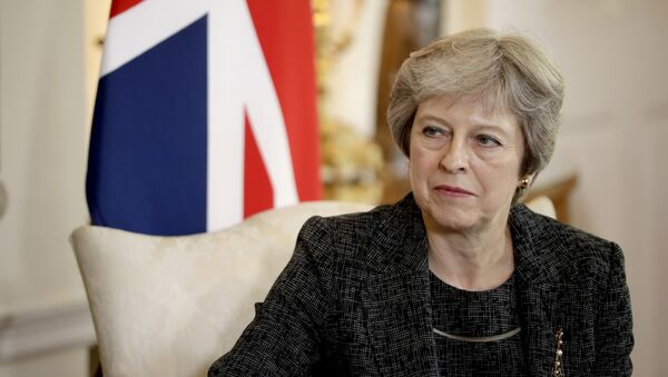 British Prime Minister Theresa May listens at the start of her meeting with the Emir of Qatar Tamim bin Hamad Al Thani inside 10 Downing Street in London, Tuesday, July 24, 2018 - Sputnik International