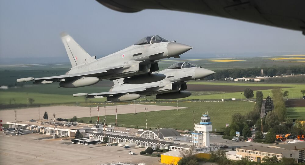 (File) Royal Air Force Eurofighter Typhoon fighter jets fly above the Mihail Kogalniceanu airport, eastern Romania, Friday, April 27, 2018