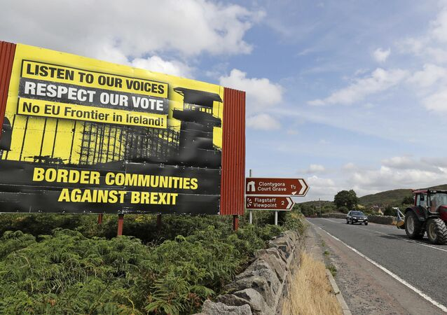 Anti-Brexit billboards are seen on the northern side of the border between Newry, in Northern Ireland, and Dundalk, in the Republic of Ireland, on Wednesday, July 18, 2018.
