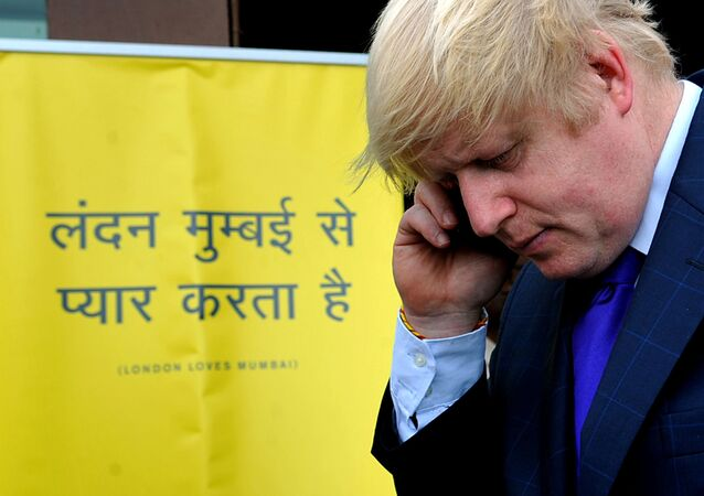 (File) Boris Johnson takes a phone call during an interaction with Indian media representatives in Mumbai on November 29, 2012