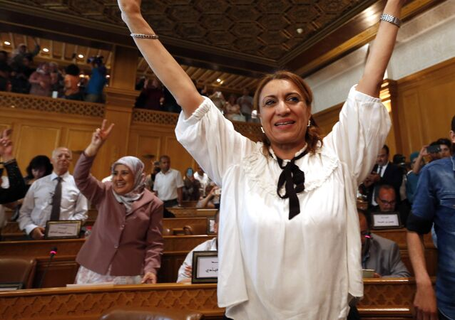 Souad Abderrahim, 54, flashes the V-sign after being elected as mayor of the Tunisian capital, Tunis, Tuesday, July 3, 2018