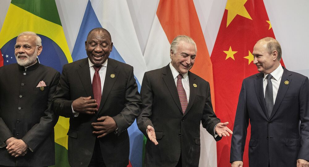 From left, Indian Prime Minister Narendra Modi, South African President Cyril Ramaphosa, Brazil's President Michel Temer and Russia's President Vladimir Putin, get ready for a group photo at the BRICS Summit in Johannesburg, South Africa, Thursday, July 26, 2018. Putin arrived in South Africa Thursday, the last head of state to arrive for the Summit