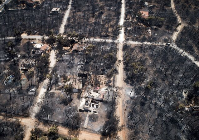 This Wednesday, July 25, 2018 aerial photo shows burnt houses and trees following a wildfire in Mati, east of Athens