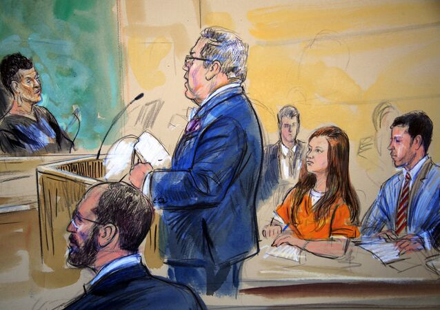 This courtroom sketch depicts Maria Butina, in orange suit, a 29-year-old gun-rights activist suspected of being a covert Russian agent, listening to her attorney Robert Driscoll, standing, as he speaks to Judge Deborah Robinson, left, during a hearing in federal court in Washington, Wednesday, July 18, 2018. Assistant U.S. Attorney Erik Kenerson, bottom left, and co-defense attorney's Alfred Carry, right, listen. Prosecutors say Butina was likely in contact with Kremlin operatives while living in the United States. And prosecutors also are accusing her of using sex and deception to forge influential connections