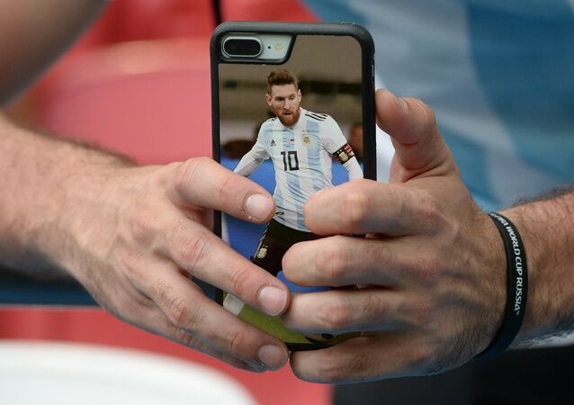 The photo of the player of Argentina national team Lionel Messi on the fan's smartphone