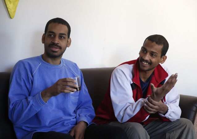 "Alexanda Amon Kotey, left, and El Shafee Elsheikh, who were allegedly among four British jihadis who made up a brutal Islamic State cell dubbed The Beatles, speak during an interview with The Associated Press at a security center in Kobani, Syria, Friday, March 30, 2018. The men said that their home country's revoking of their citizenship denies them fair trial. ""The Beatles"" terror cell is believed to have captured, tortured and killed hostages including American, British and Japanese journalists and aid workers"