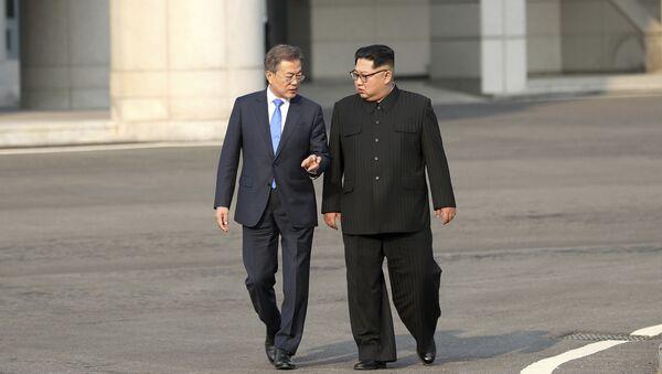 North Korean leader Kim Jong-un, right, talks with South Korean President Moon Jae-in at the border village of Panmunjom in the Demilitarized Zone, South Korea, Friday, April 27, 2018 - Sputnik International