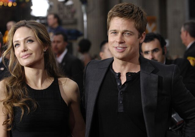 In this June 5, 2007 file photo, Brad Pitt, right, a cast member in the film Ocean's Thirteen, arrives with Angelina Jolie at the premiere of the film at Grauman's Chinese Theatre in Los Angeles. Angelina Jolie Pitt has filed for divorce from Brad Pitt, bringing an end to one of the world's most star-studded, tabloid-generating romances. An attorney for Jolie Pitt, Robert Offer, said Tuesday, Sept. 20, 2016, that she has filed for the dissolution of the marriage