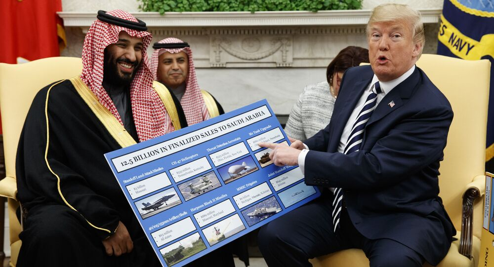 President Donald Trump shows a chart highlighting arms sales to Saudi Arabia during a meeting with Saudi Crown Prince Mohammed bin Salman in the Oval Office of the White House, Tuesday, March 20, 2018, in Washington