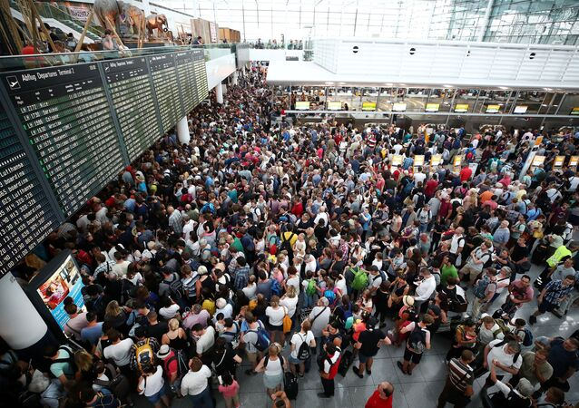 Passengers wait for their flights in Terminal 2, after it has been temporarily closed due to a police operation, at Munich's international Airport, Germany, July 28, 2018