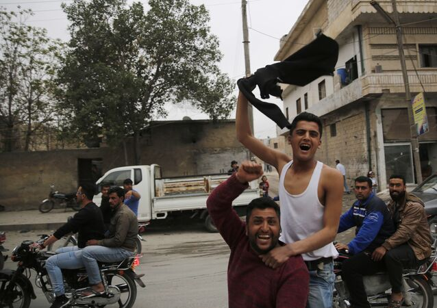 In this photo taken on Wednesday, March 28, 2018, Syrian soccer fans celebrate after their local team won a game, in Manbij, north Syria. Manbij, a mixed Arab and Kurdish town of nearly 400,000, was liberated from Islamic State militants in 2016 by the YPG fighters with backing from U.S-led coalition airstrikes. With Turkey's threats, the town has become the axle for U.S. policy in Syria, threatening its prestige and military deployment in eastern Syria
