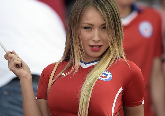 Chilean model Daniella Chavez cheers for her team before the start of the 2015 Copa America football championship final Argentina vs Chile, in Santiago, Chile, on July 4, 2015