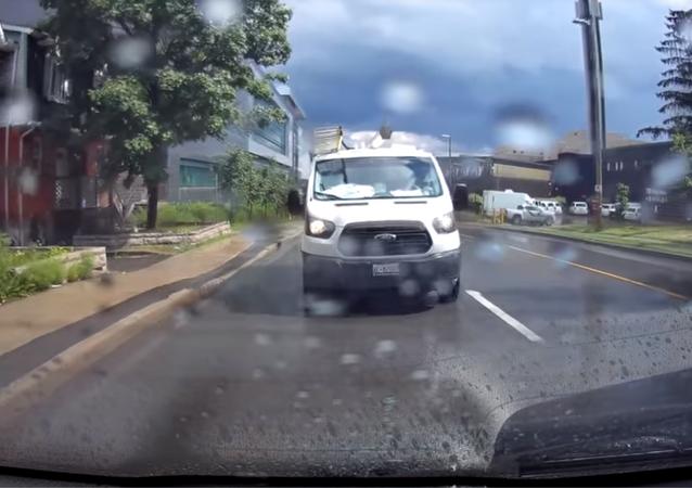 Van splashing pedestrians