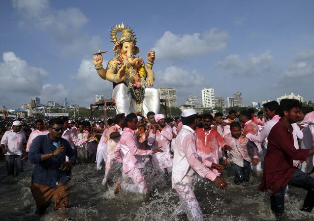 Hindu devotees pull a giant idol of the elephant-headed god Ganesha to immerse it in the Arabian Sea on the final day of the ten-day long Ganesh Chaturthi festival in Mumbai, India, Tuesday, Sept. 5, 2017
