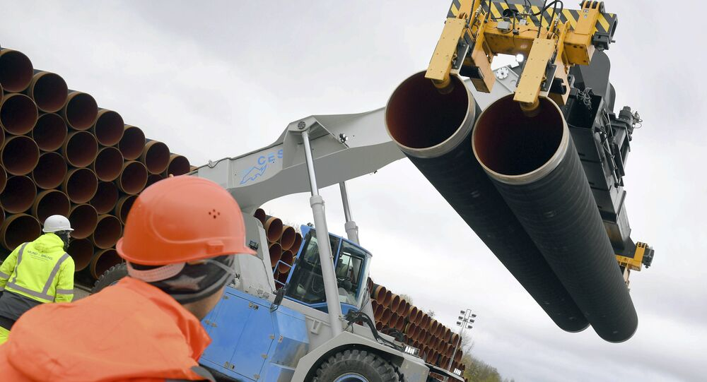 In this May 8, 2017 photo steel pipes for the North Stream 2 pipeline are uploaded in Mukran harbour in Sassnitz, Germany