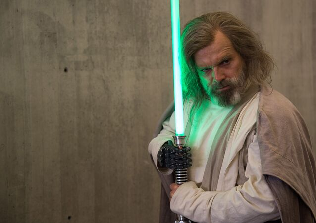 An attendee dressed as Luke Skywalker from Star Wars poses at New York Comic Con at the Javits Center on Friday, Oct. 7, 2016, in New York
