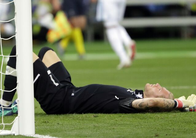 In this May 26, 2018, file photo, Liverpool goalkeeper Loris Karius reacts after Real Madrid's Gareth Bale scored during the Champions League final soccer match at the Olimpiyskiy Stadium in Kiev, Ukraine. Doctors based in Boston have concluded Karius sustained a concussion during last month's Champions League final that would have affected his performance